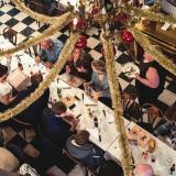 Diners sitting at a table in Chez Louisette at Christmas time