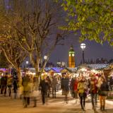 People browsing Christmas stands on the south bank with Big Ben in the background