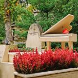 Elaborate grave with a piano on top