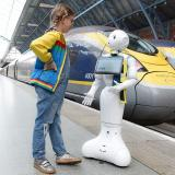 Pepper our Robot talking to a young passenger