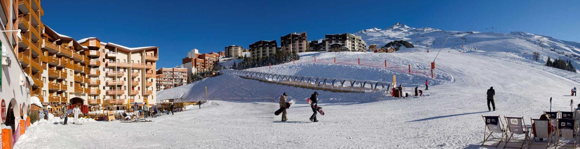 Skiers walking across the snow