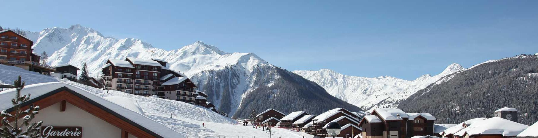 panorama of Peisey Vallandry village with mountains in the background