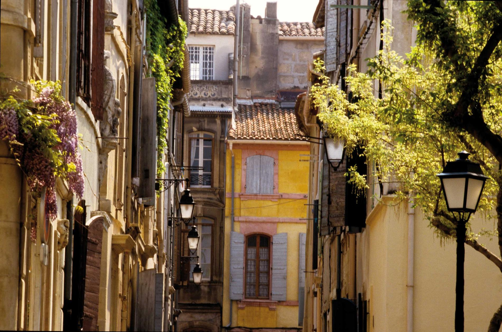 A narrow street with brightly coloured houses in Aix-en-Provence
