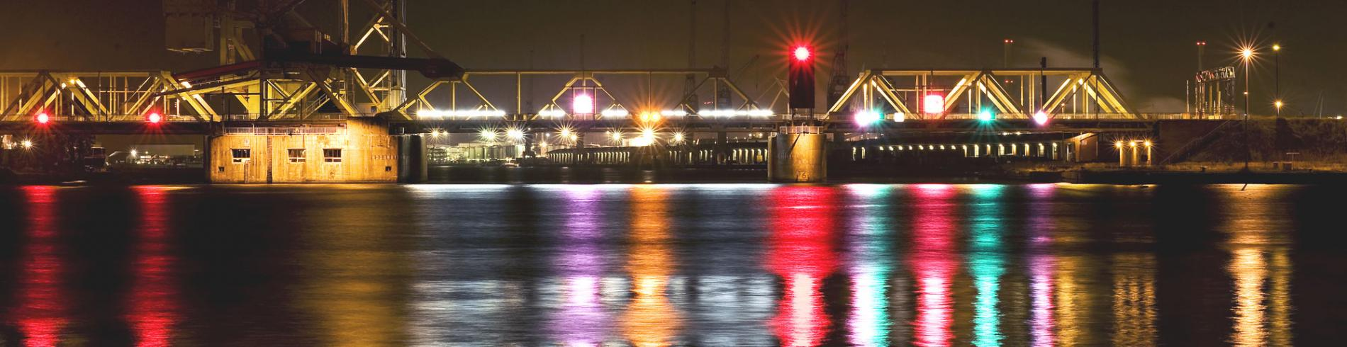 View of the docks at night with colourful reflections on the water