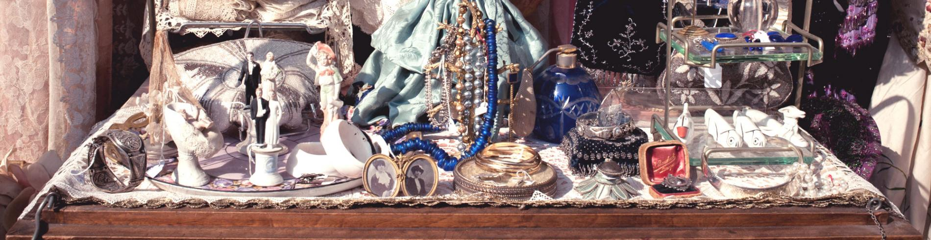 Table with piles of jewellery and little ornaments
