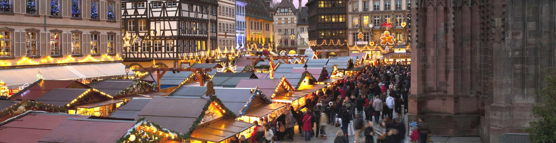 Christmas markets stalls around the cathedral by night