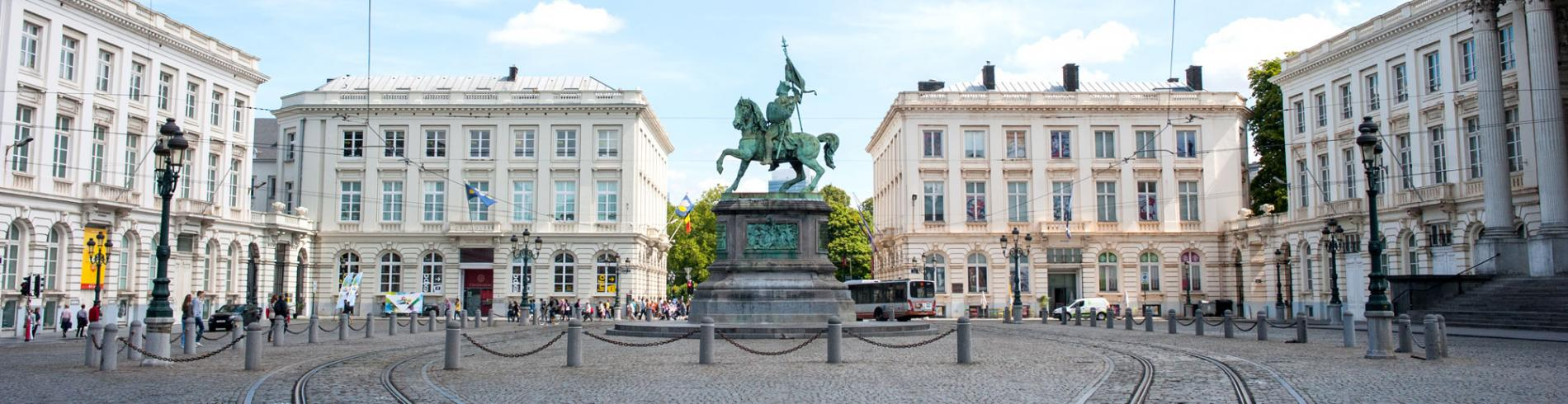 Large open square with a statue of a man on horseback in the centre