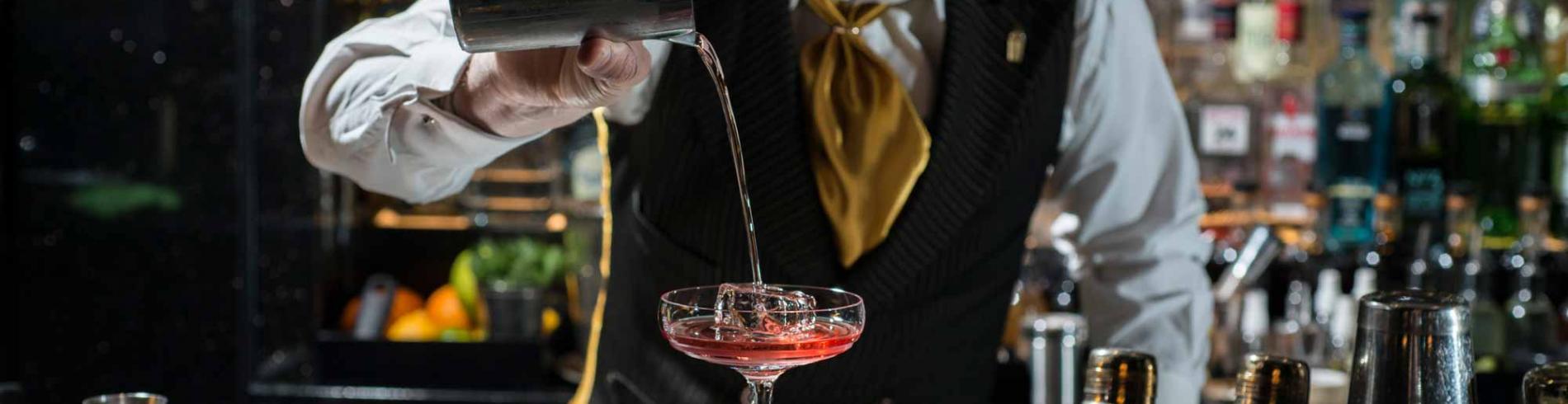 A bartender pours a drink at Beaufort Bar