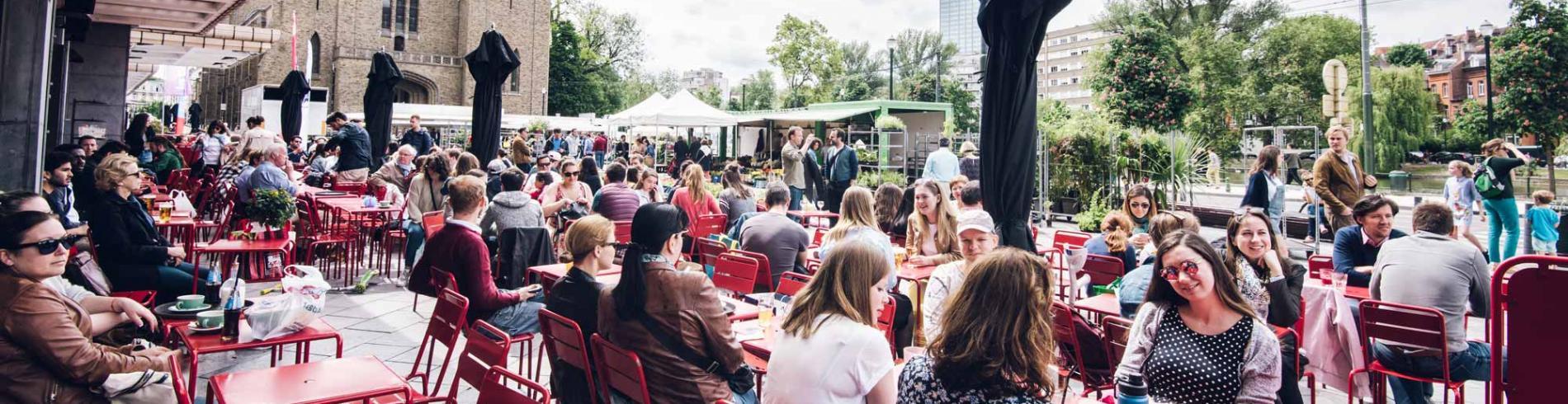 People enjoying drinks at Cafe Belga