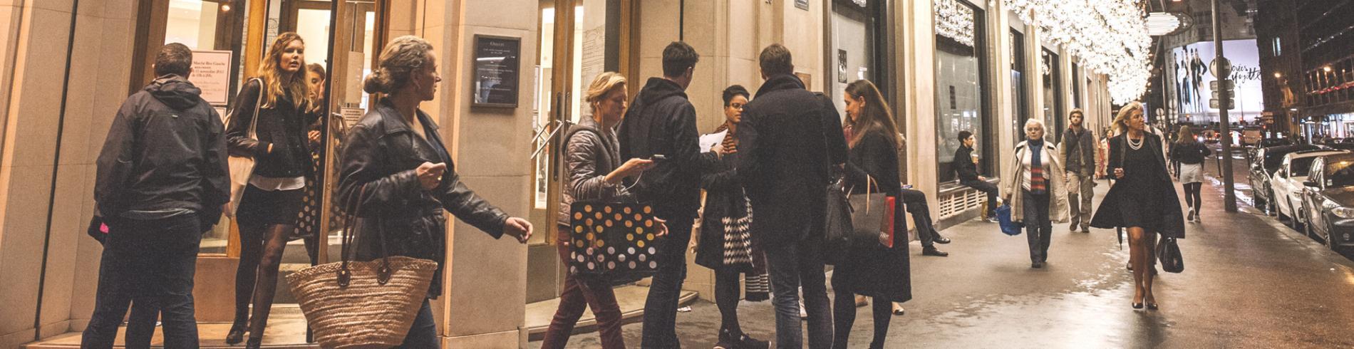 Shoppers outside Le Bon Marché store