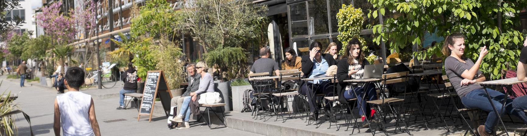 People sitting outside a cafe in the 18th Arrt.