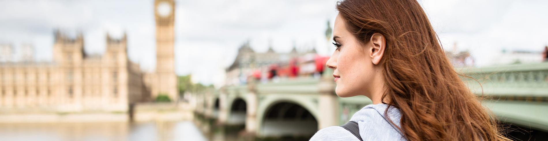 girl looking over the Parliament in London