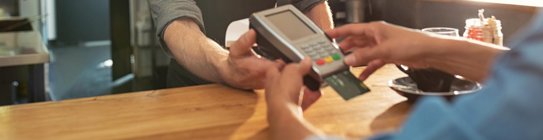 Person paying by credit card
