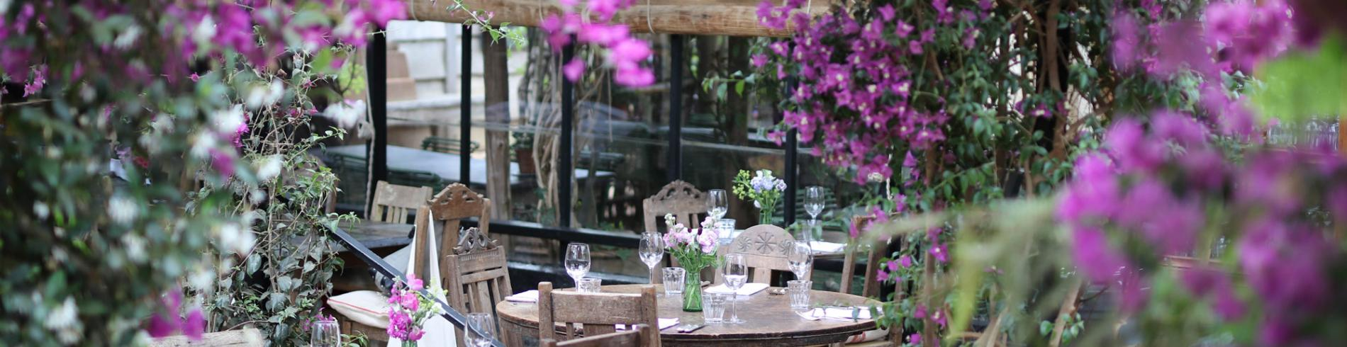 Purple flowers and dining tables at Petersham Nurseries in Richmond