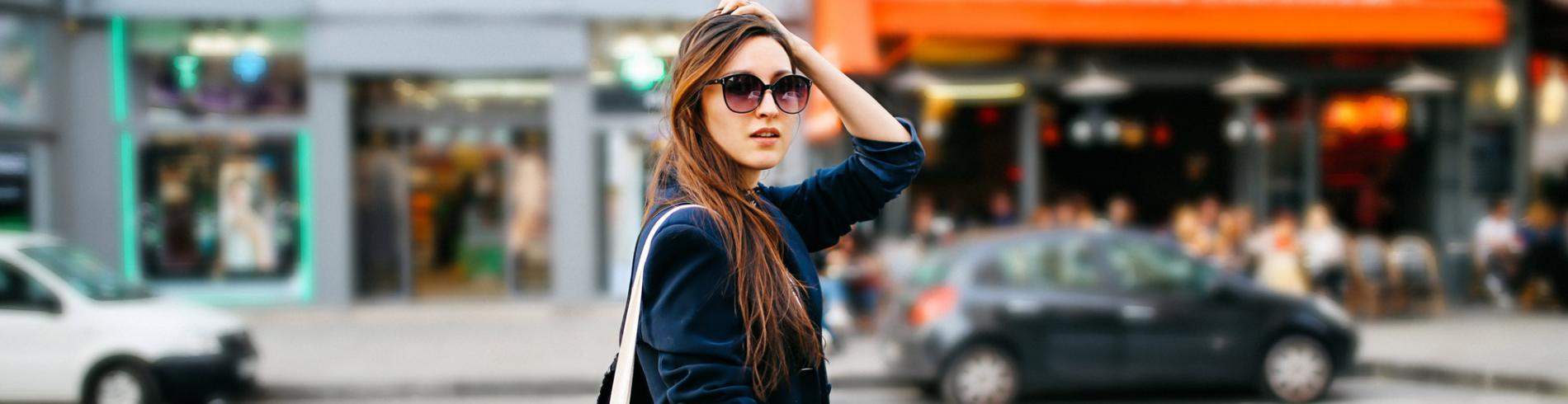 Stylish woman with shopping bag and sunglasses