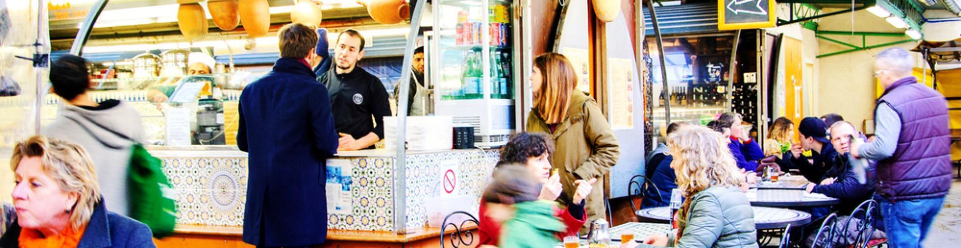 People eat at Marche des Enfants Rouges