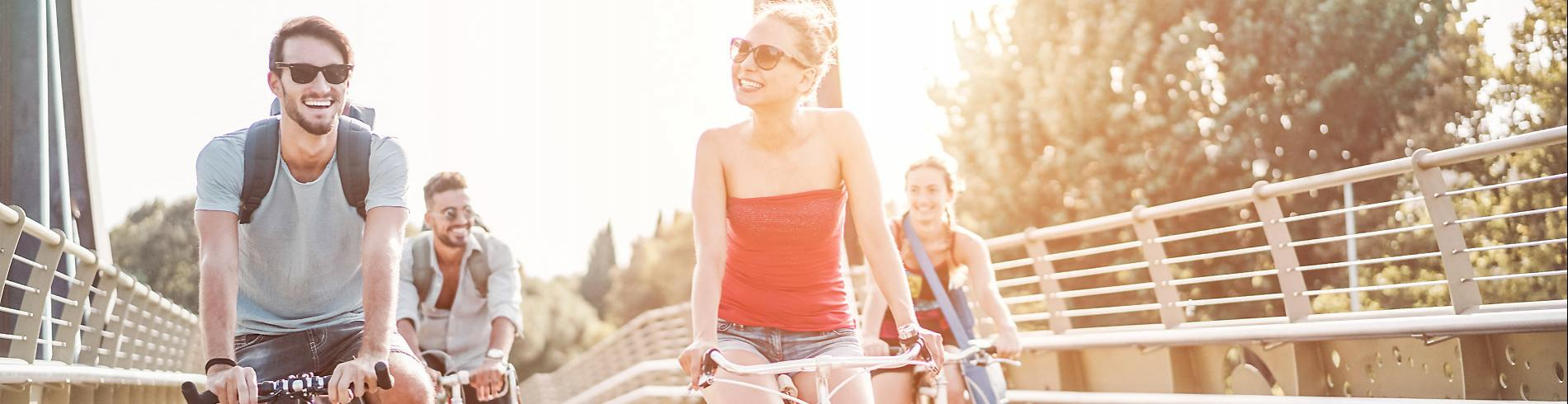 Happy people on bikes on a sunny day