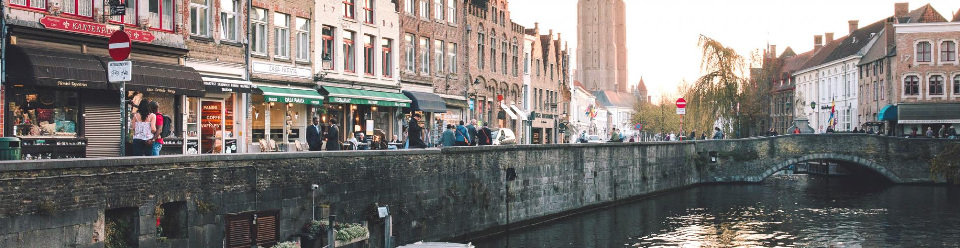 Shops along the side of a canal in Bruges