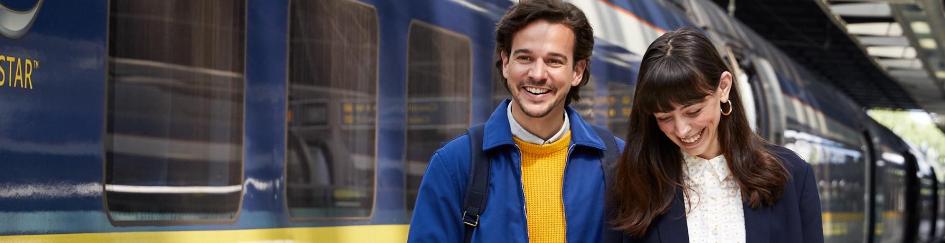 Man and woman by Eurostar train
