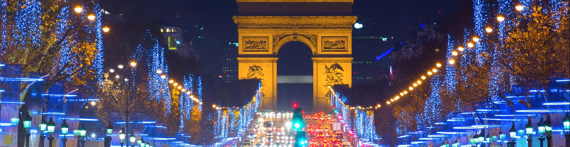 The Champs Elysees and the Arc de Triomphe lit up with Christmas lights
