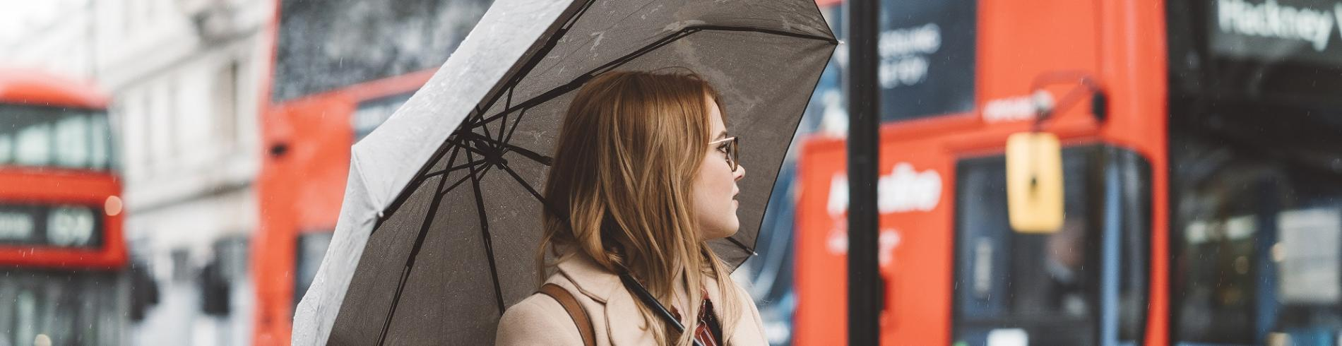 Girl with umbrella in London