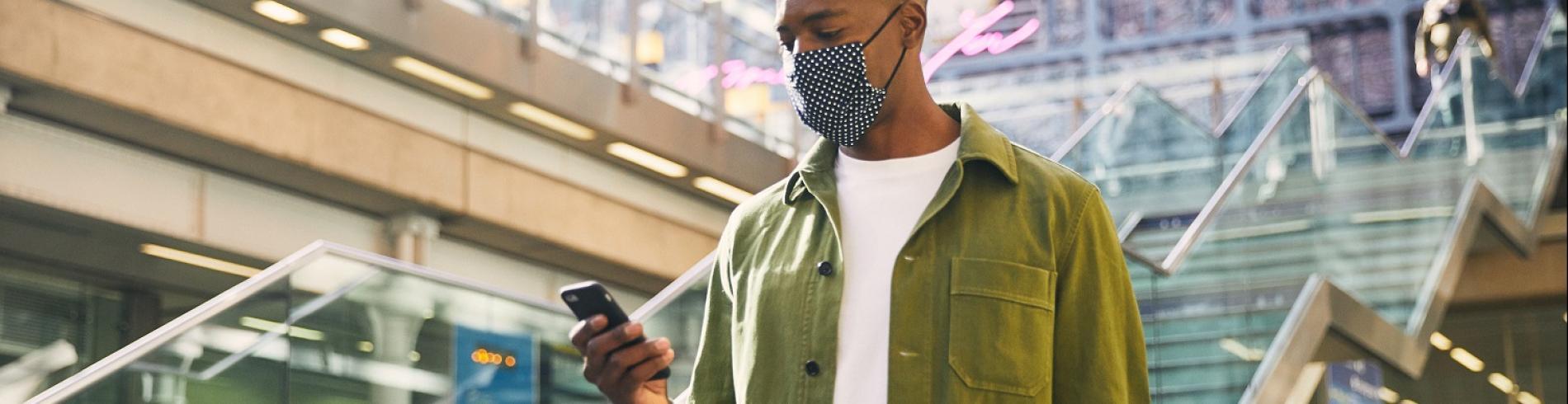 masked man in St Pancras International