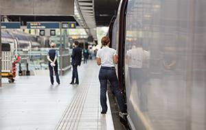 Woman boarding a European train