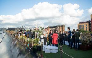 People enjoying drinks at Dalston Roof Park