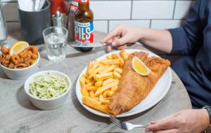 A plate of fish and chips served at Kerbisher