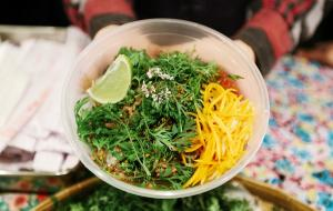 Big bowl of brightly coloured vegan food