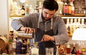 A bartender makes drinks at the Frenchie in Covent Garden