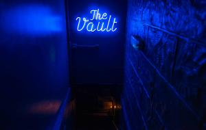 Neon sign at The Vault in Soho