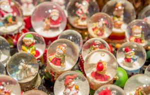 Lots of different snow globes with Christmas characters