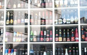 Hundreds of different beers in a shop window