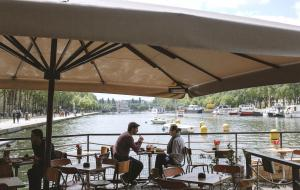 Couple having lunch on a boat on the Seine