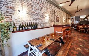 Exposed brick and white tile decor at Faggio