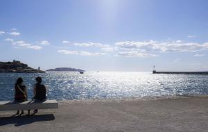 Couple sitting outside the MuCEM museum looking out at the sea