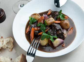 Hearty bowl of stew served with crusty bread