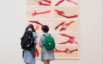 Two school children looking at art in the Tate Modern