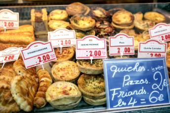 Quiches and sausage rolls on a stand at President Wilson Market