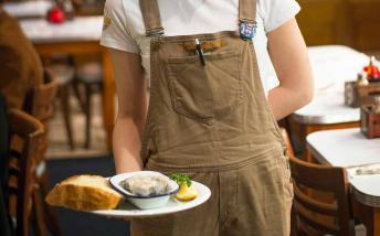 A waitress serving food at Poppies