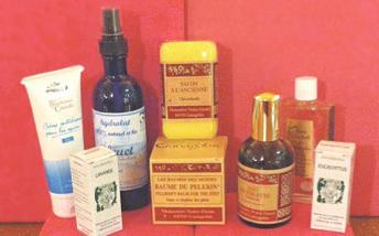 Selection of Artisanat Monastique products against a red background
