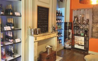 Interior of the shop with lots of bottles of fizz
