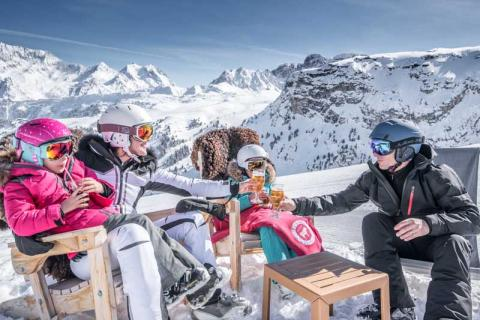 family having a drink on the slopes