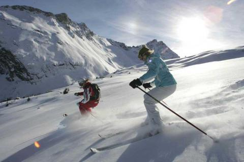 Skiers on the slopes in Courchevel