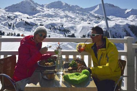 Skiers eating on a terrace in La Plagne