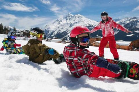 Kids learning to snowboard