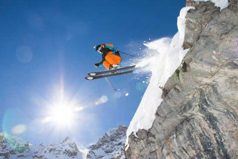 Skier skiing off a cliff