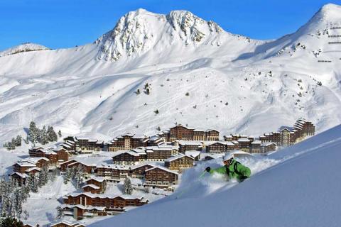 Skier on the slopes above La Plagne