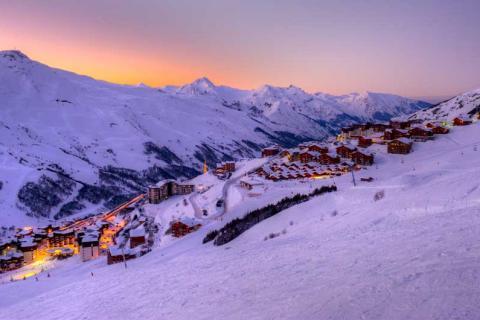 View of Les Menuires village at sunset